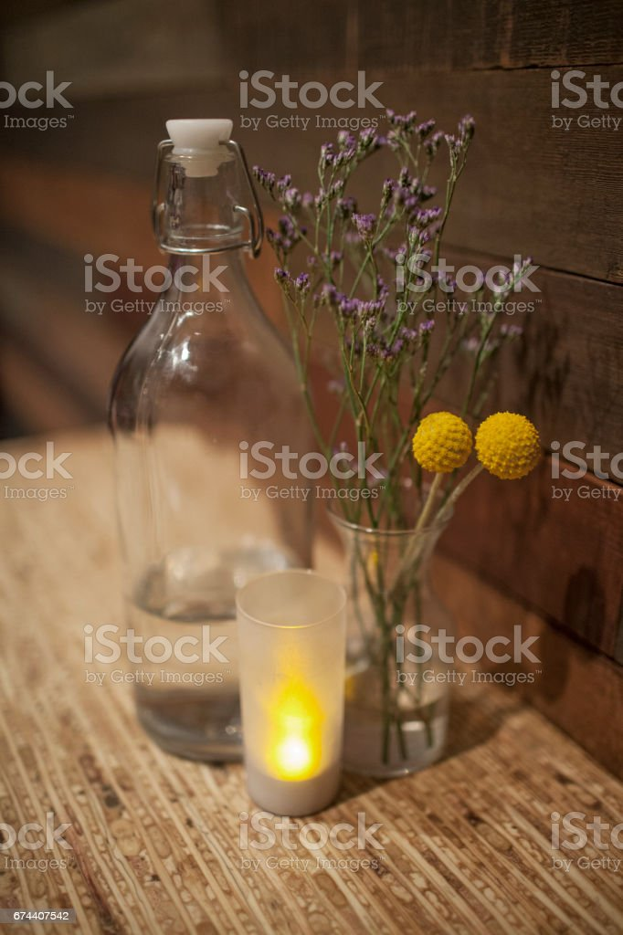 Dried purple and yellow flowers in ball glass jar between vintage dried purple and yellow flowers in ball glass jar between vintage water bottle and small candle mightylinksfo