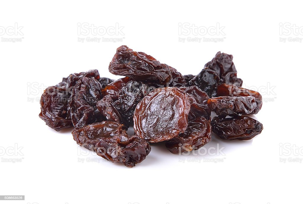 Dried raisins on a white background stock photo