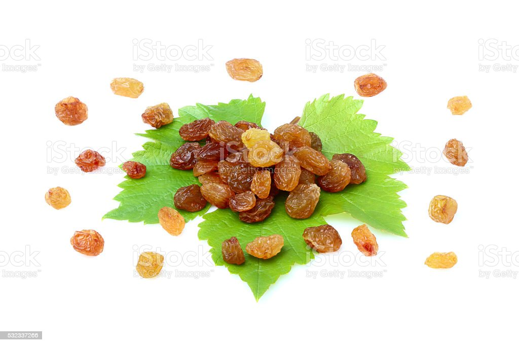 Dried raisins scattered on the leaf. stock photo