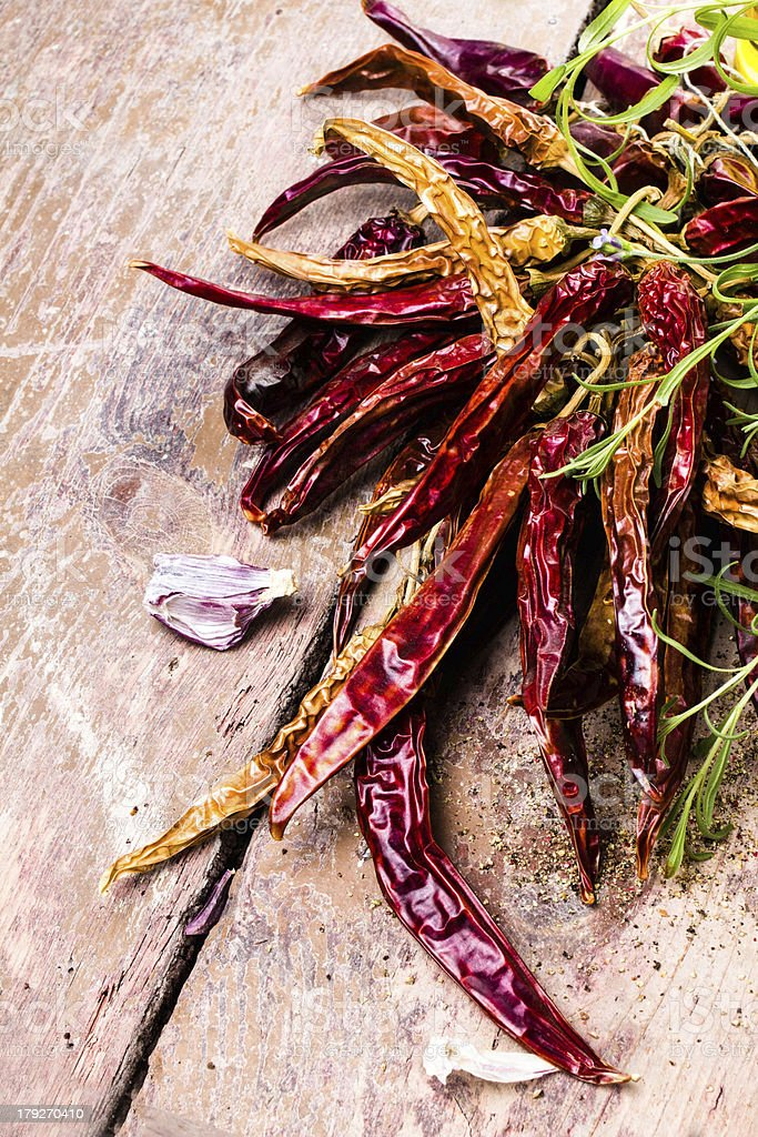 Dried red hot chilli pepper on dark vintage wooden background royalty-free stock photo