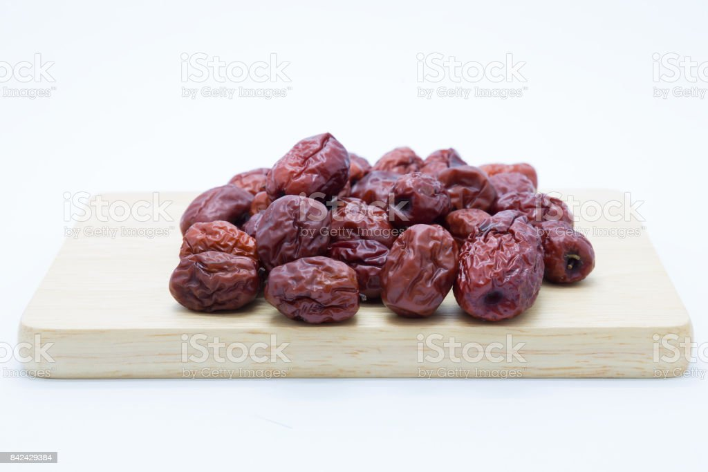 Dried red jujube on wooden board stock photo
