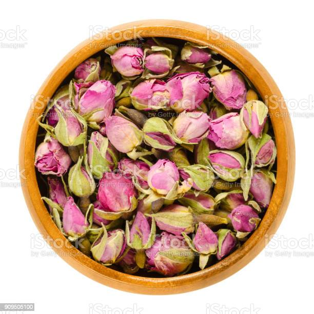 Dried rose buds in wooden bowl over white picture id909505100?b=1&k=6&m=909505100&s=612x612&h=komiau  eahyw3grsiqdp7lwpsf dnsqyl 1yhn6 wu=
