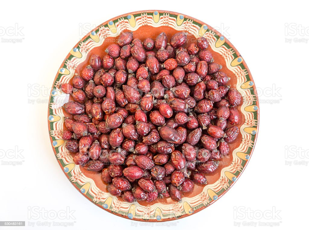 Dried rose hips plate stock photo