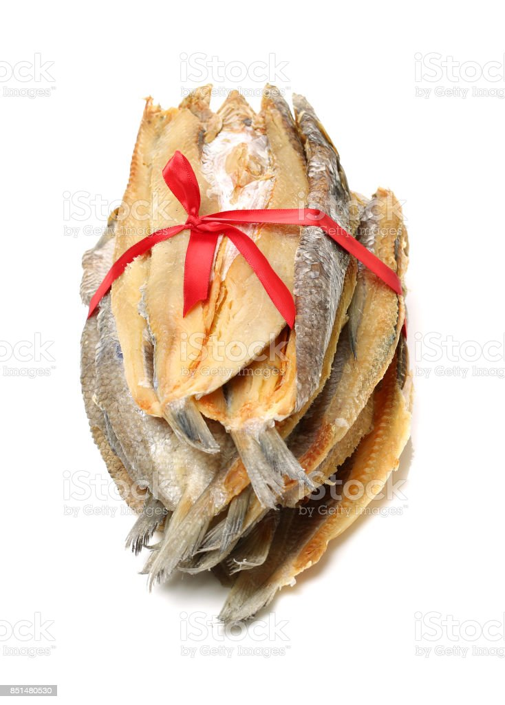 Dried salted fishes On White Background stock photo