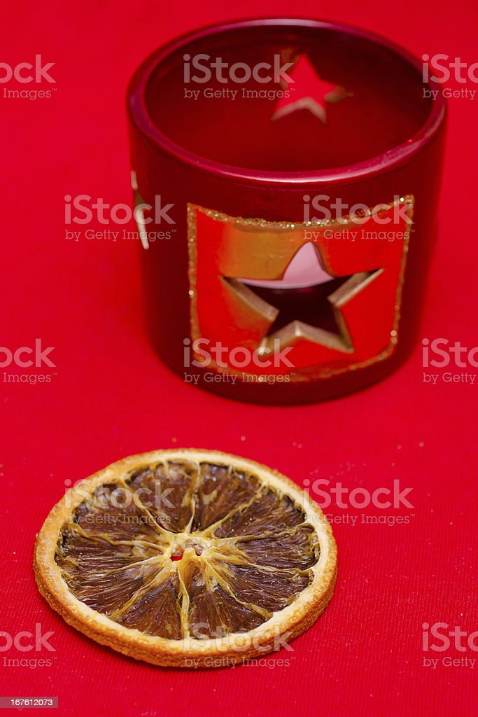Dried slice of an orange and a candlestand stock photo