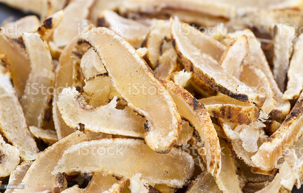 Dried sliced roasted cowskin ready for eat stock photo