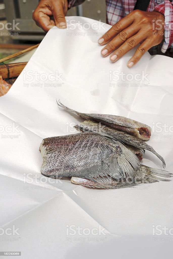 Dried Snakeskin gourami in paper packing royalty-free stock photo