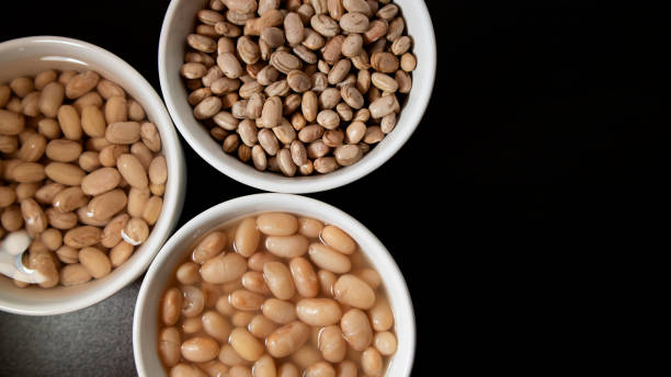 Dried, soaking in water and cooked Pinto beans stock photo