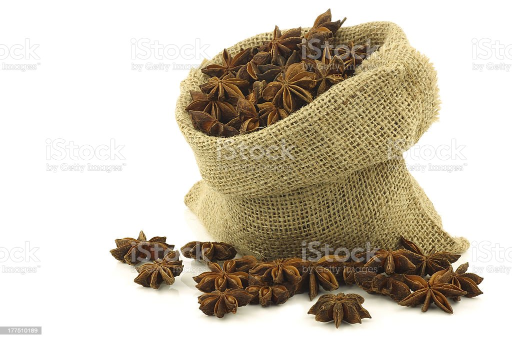 dried star anise (Illicium verum) in a burlap bag royalty-free stock photo