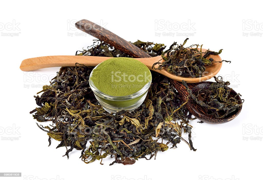 Dried tea leaf and powder with wooden spoon royalty-free stock photo