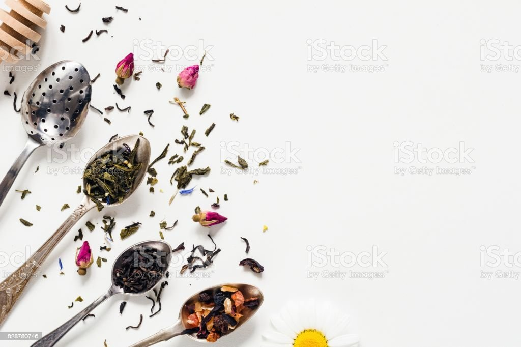 Dried tea leaf in tea spoons on white background stock photo