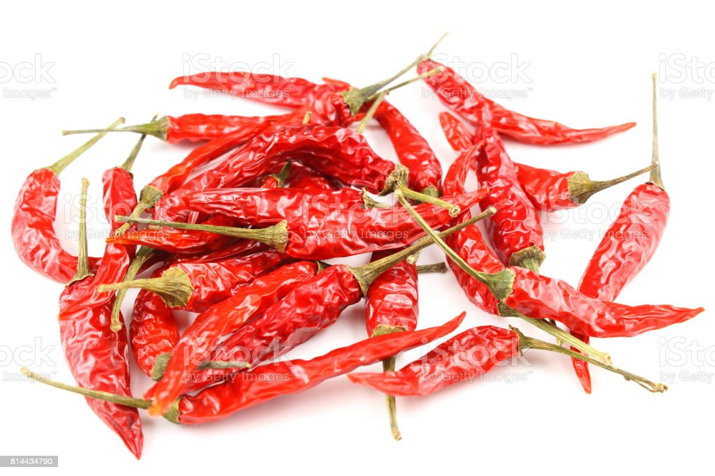 dried thai chili peppers isolated on a white background stock photo