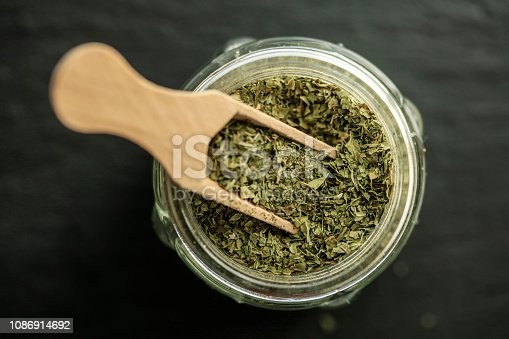 Dried thyme on wooden spoon