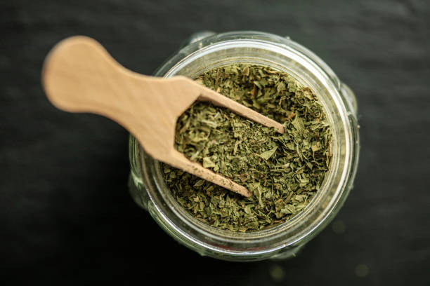 Dried thyme on wooden spoon stock photo