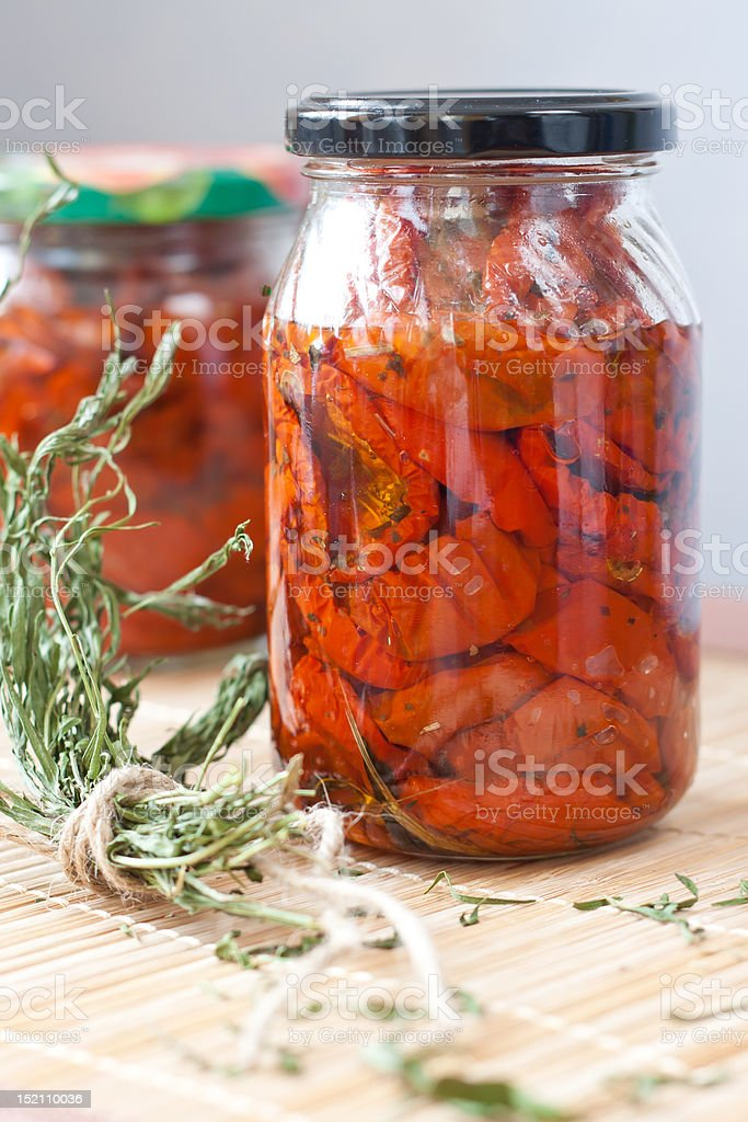 Dried tomatoes in the jar royalty-free stock photo