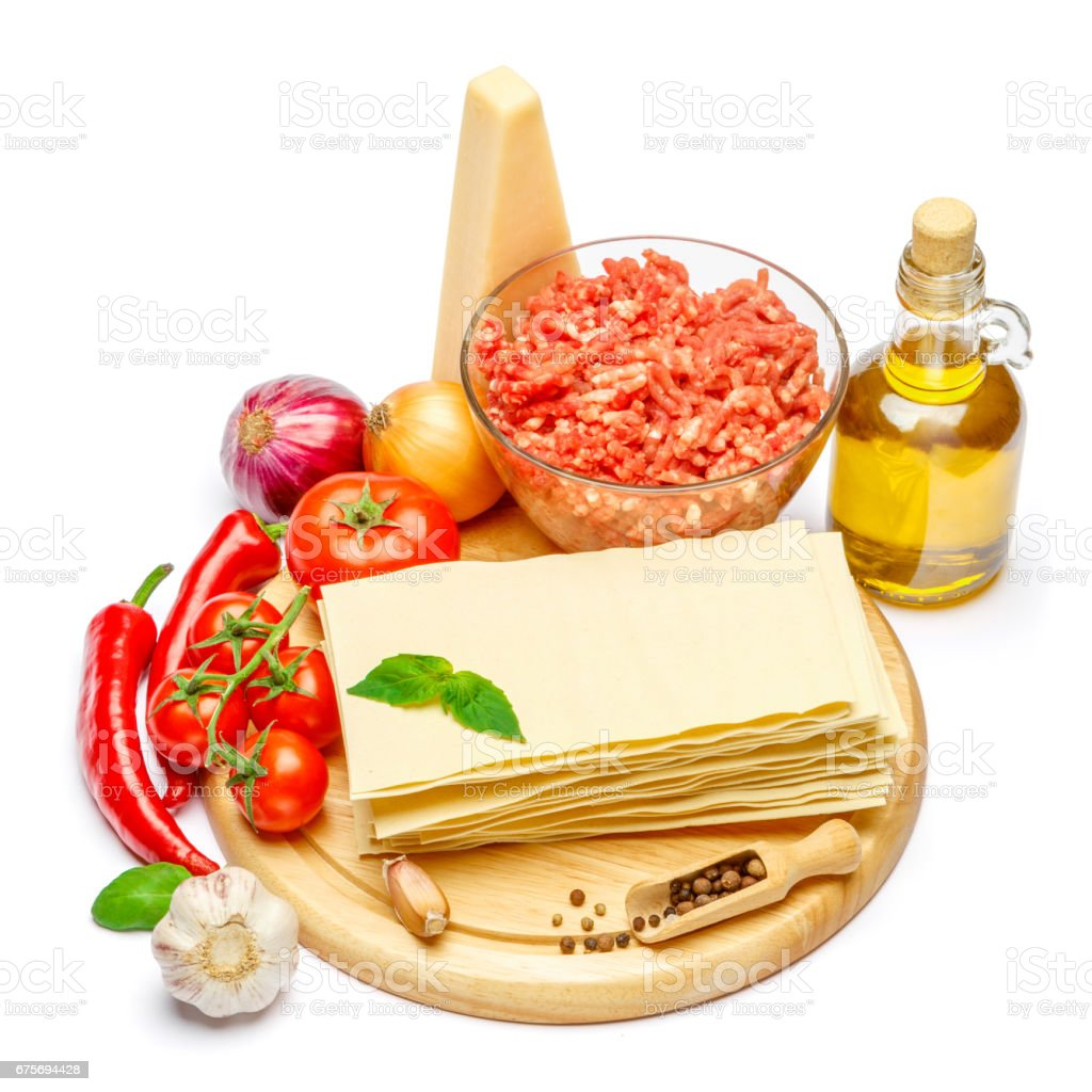 dried uncooked lasagna pasta sheets and vegetables royalty-free stock photo