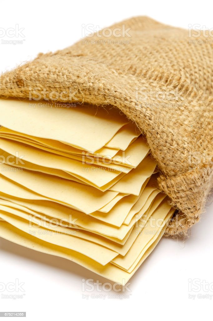 dried uncooked lasagna pasta sheets in bag royalty-free stock photo