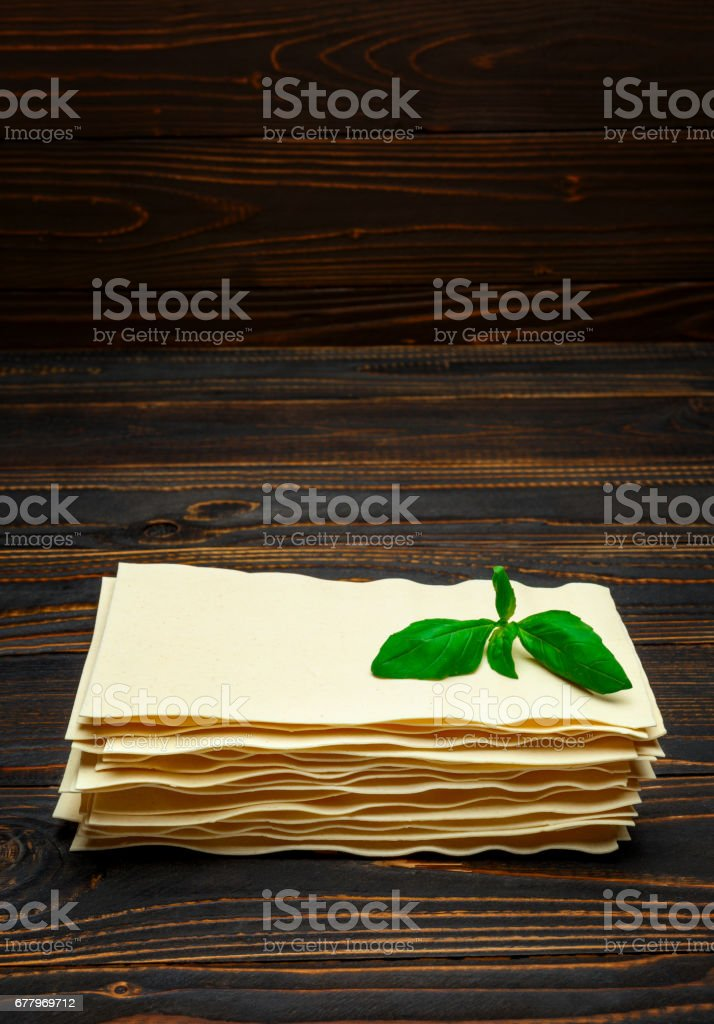 dried uncooked lasagna pasta sheets royalty-free stock photo