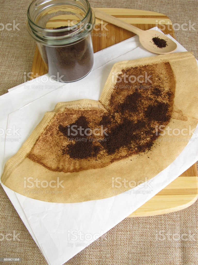Dried used coffee grounds waste product for peeling, cleaning agent or fertilizer stock photo