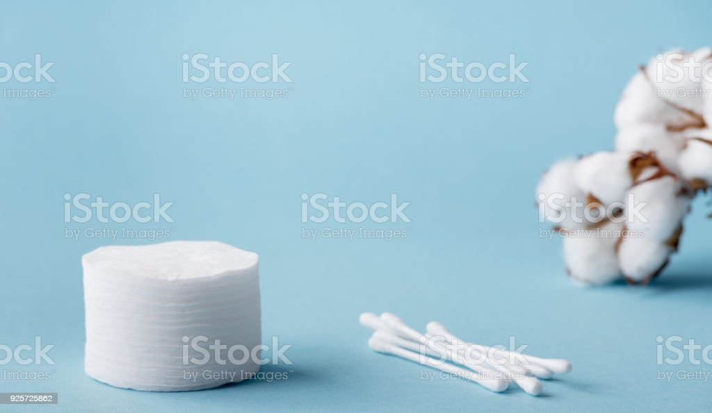 Dried white fluffy cotton flower cotton swabs and cotton pads on a...