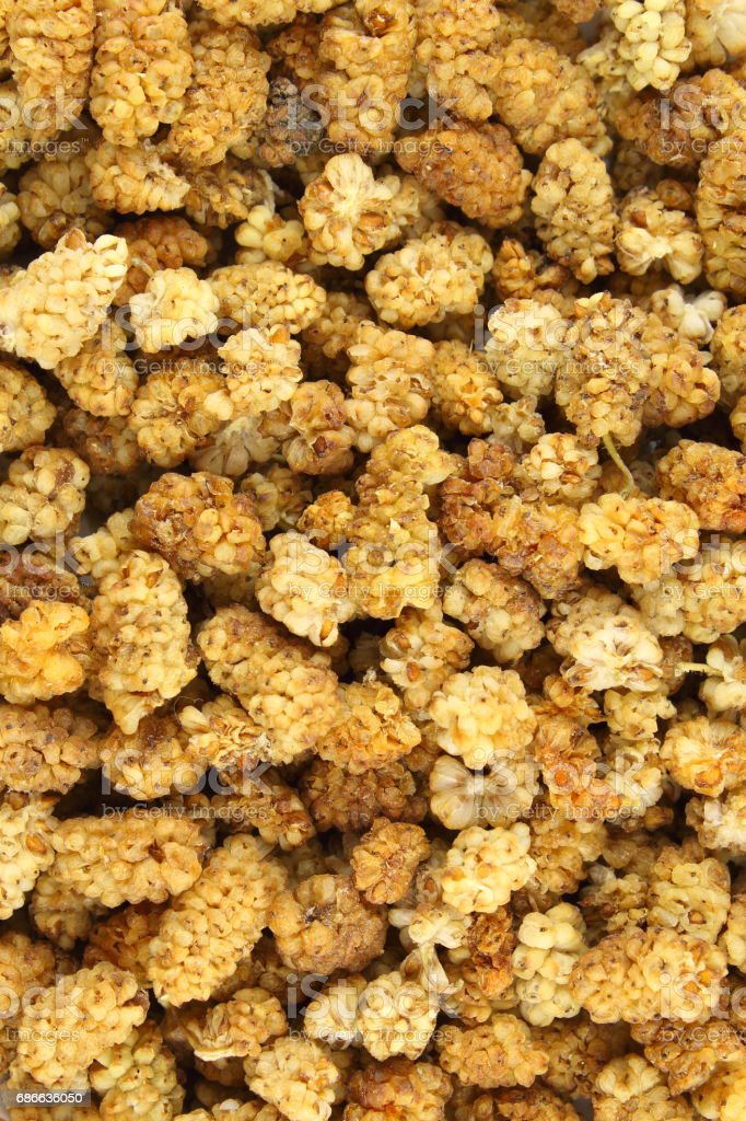 dried white mulberry fruits closeup food background texture royalty-free stock photo