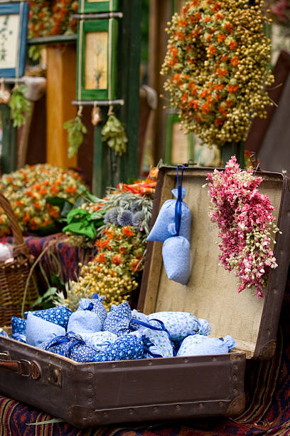 Dried wild flowers and handmade decor in old fashioned suitcase stock photo