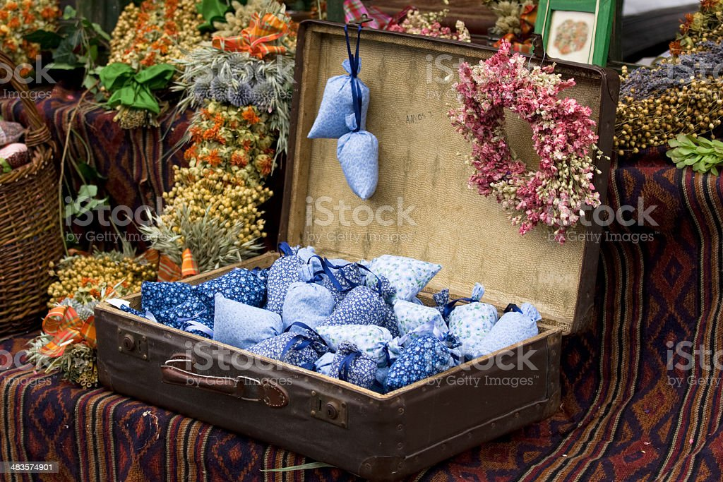 Dried wild flowers and handmade decor in old fashioned suitcase royalty-free stock photo