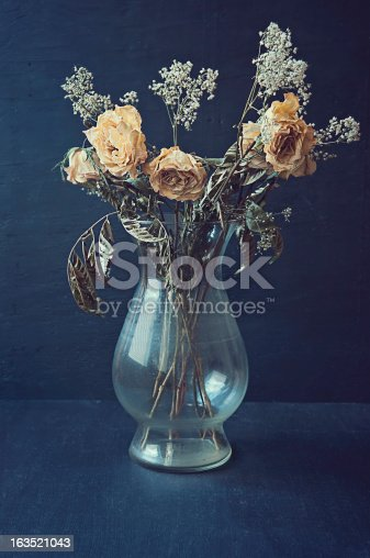 Dried Yellow Roses in a Vase