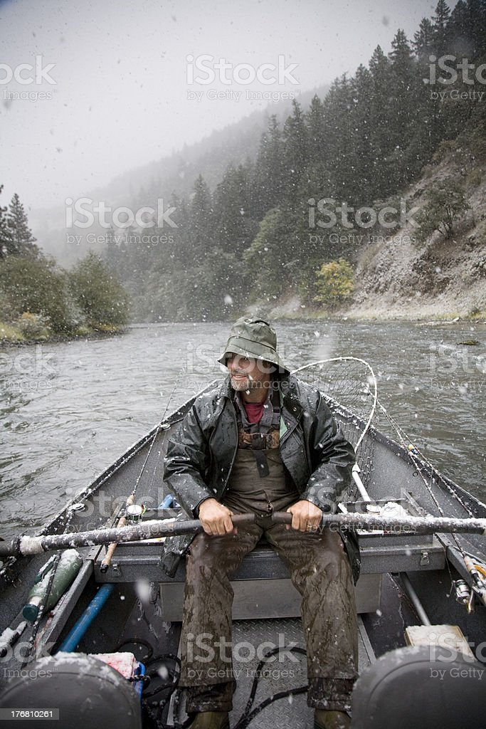Drift Boat Fisherman in the Snow stock photo