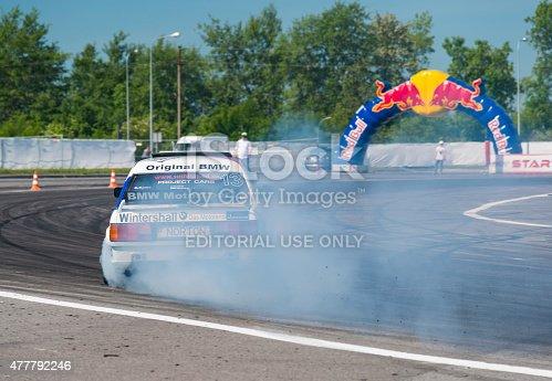 640042252 istock photo Drift car brand BMW overcome turn track 477792246