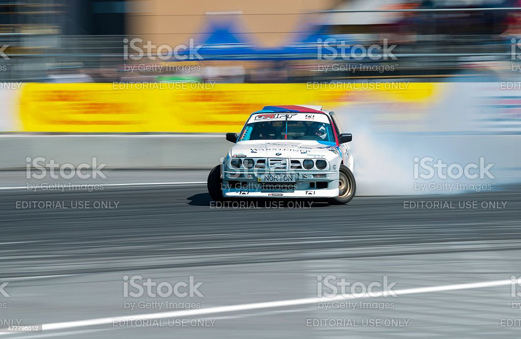 Rider Yezerov Ruslan on the car brand BMW overcomes the track in the...