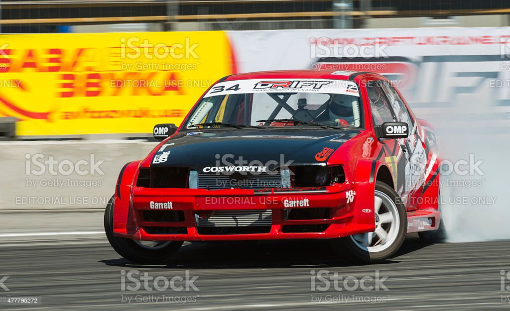 Unknown rider on the car brand Ford overcomes the track in the...