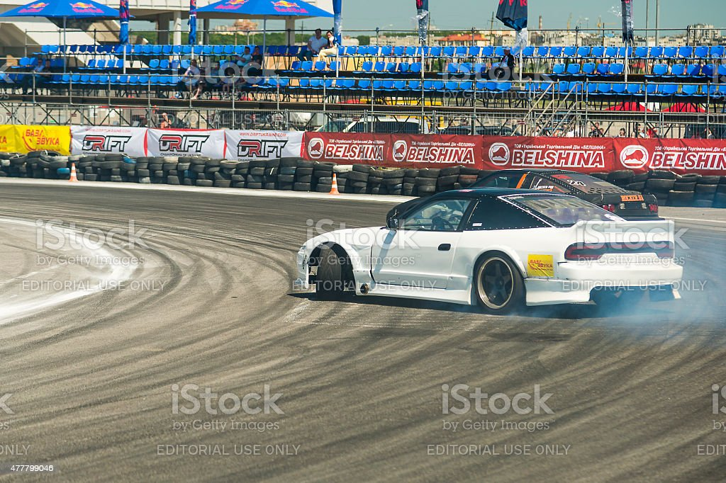 Drift cars brand Nissan overcome turn track stock photo