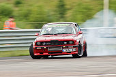 """""""Kaunas, Lithuania - July 3, 2011: Eastern European Drift Championship third stage at Lithuania race track 'Nemunas ring'. Here is BMW E30 with turbo engine running qualification runs at the drift track."""""""