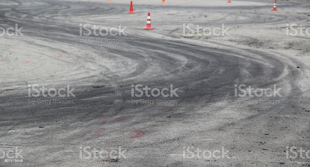 Drift track with traces of drifting vehicles between safety cones stock photo