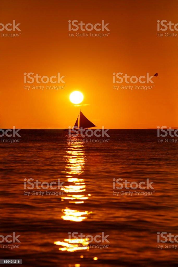 Drifting boat on a sunset. Coast of the Pacific ocean. Island Boracay stock photo