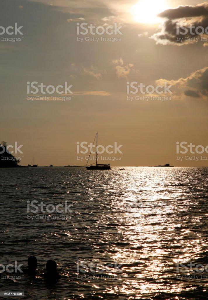 Drifting boat on a sunset. Malaysia. Langkawi stock photo
