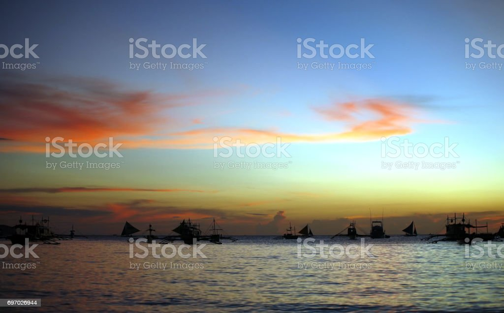 Drifting boat on a sunset on the tropical island. Philippines stock photo
