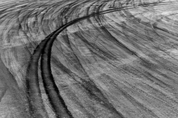 Drifting car Top view aerial photo from flying drone of a professional driver drifting car on asphalt track. tire track stock pictures, royalty-free photos & images