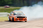 """""""Kaunas, Lithuania - July 2, 2011: Eastern European Drift Championship third stage at Lithuania race track 'Nemunas ring'. Here is BMW E30 drifting high speed corner at one of his qualification runs."""""""