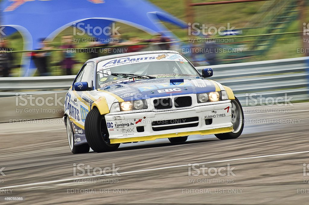 BMW E36 drifting with full lock stock photo