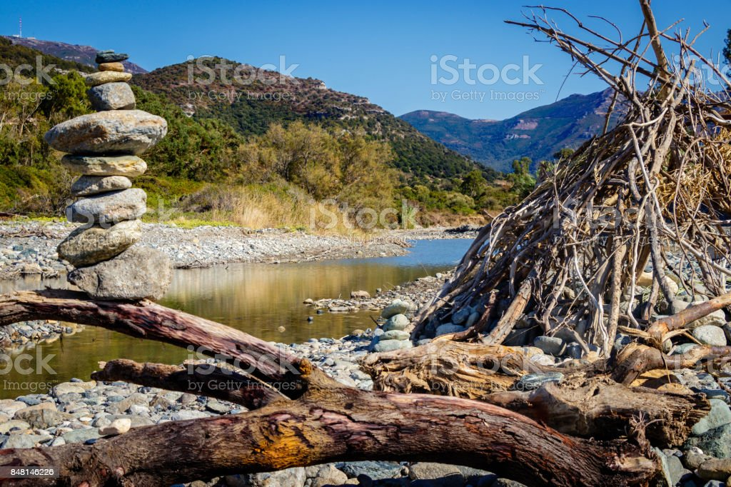 Drifting wood and cairn stock photo