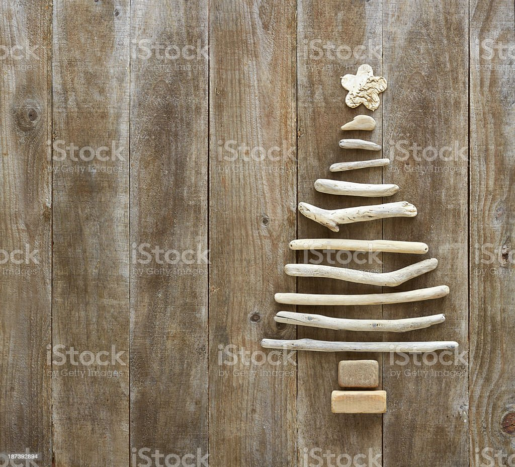 Driftwood Christmas tree on a rustic wood background. stock photo