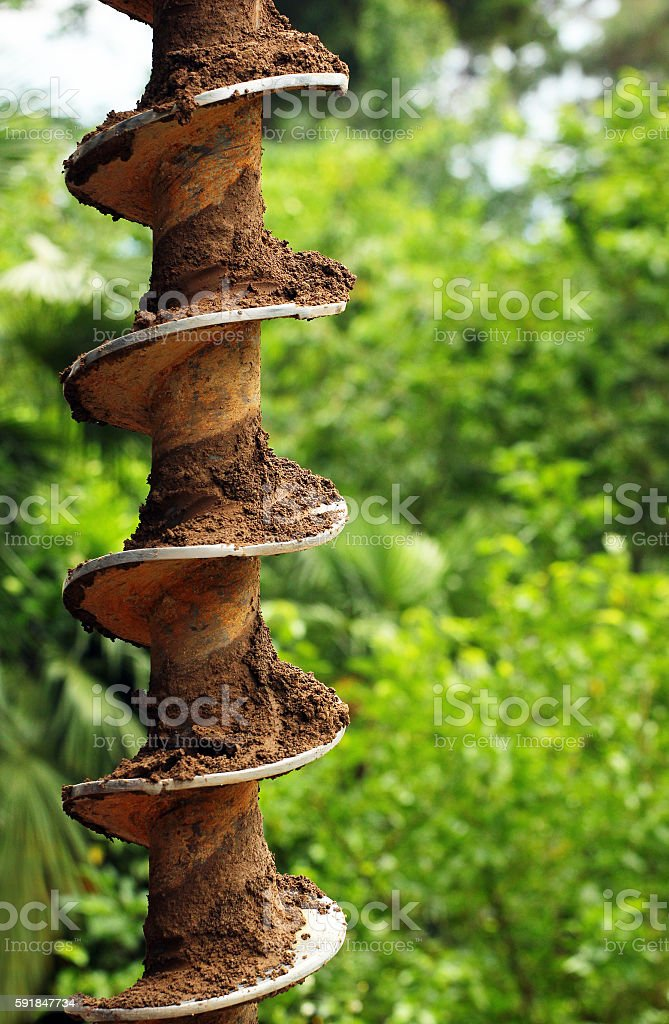 Drill auger with ground and dirt stock photo