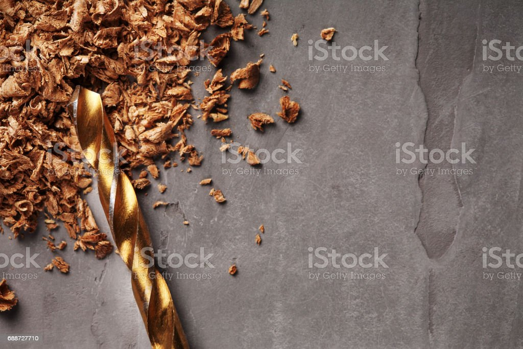drill bit on a dark stone in workplace stock photo