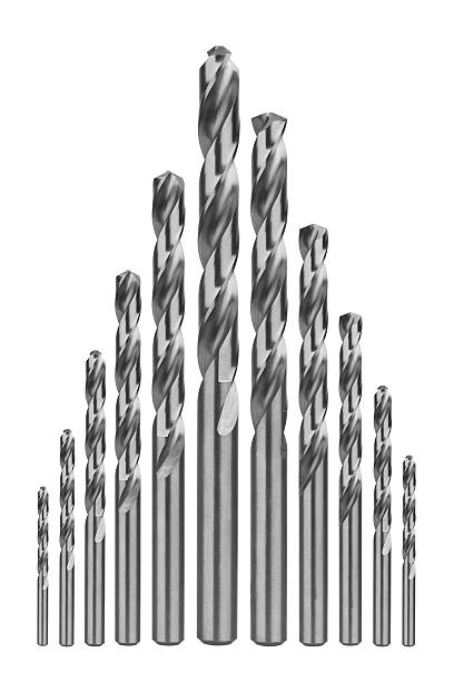 Drill bits of different sizes Drill bits of different sizes, isolated on white background drill bit stock pictures, royalty-free photos & images