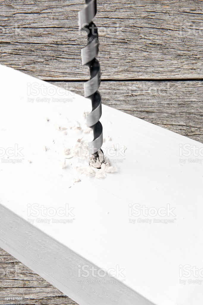 Drill drilling a hole into beam stock photo