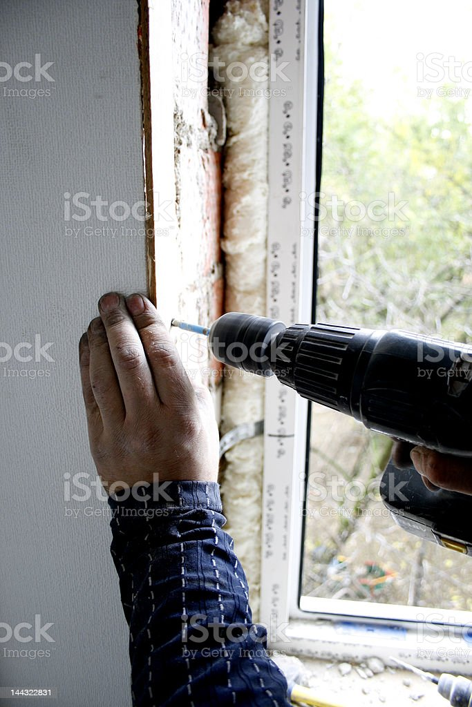 Drill  into a wall royalty-free stock photo