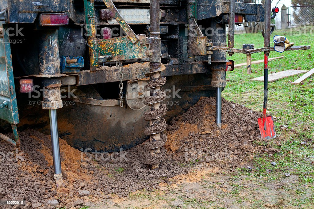 drill is digging a hole royalty-free stock photo