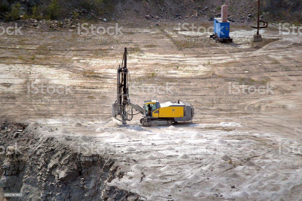 drill machine closeup on a granite quarry stock photo